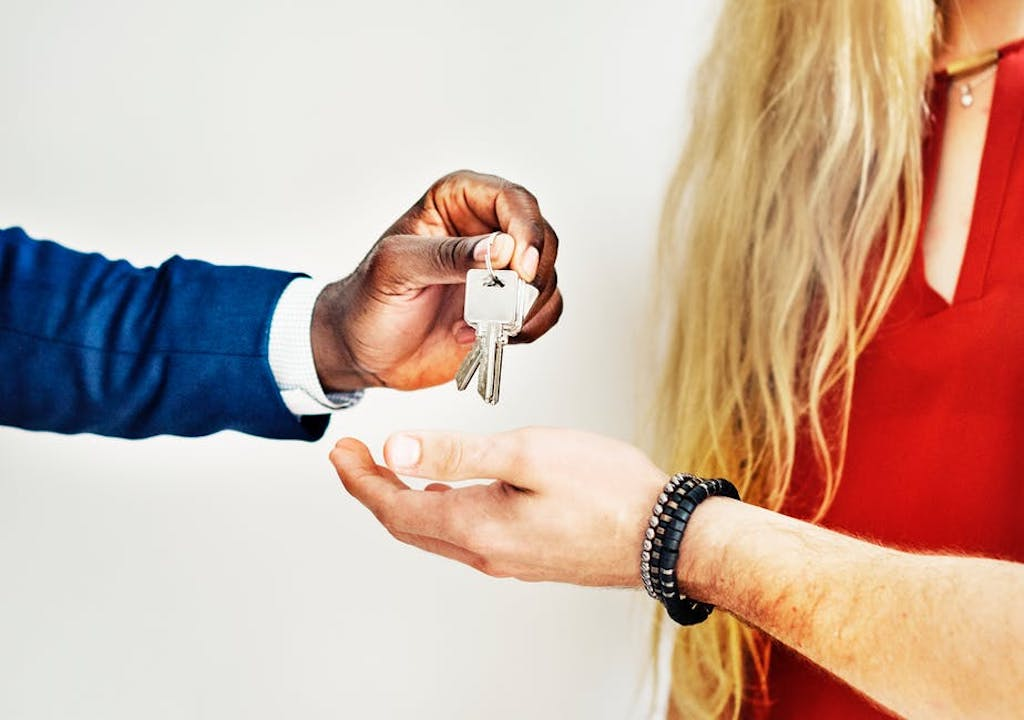 man giving a key to a woman (investment)