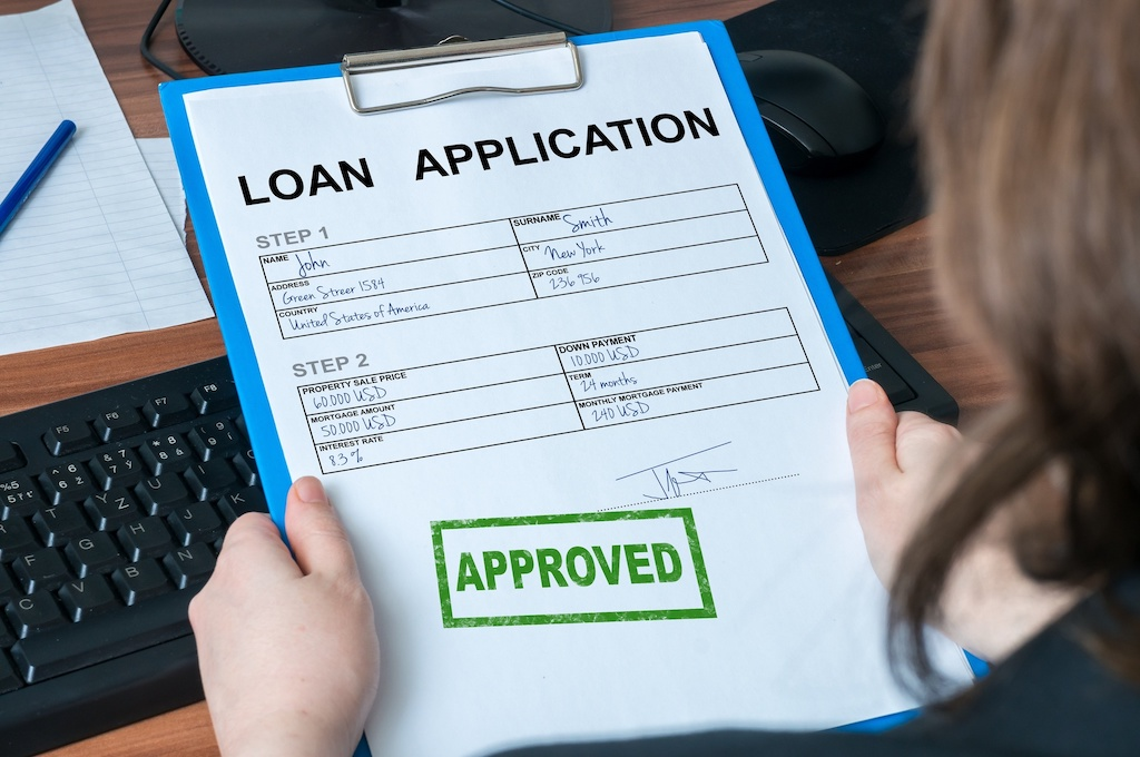 Loan application form with approved stamp.