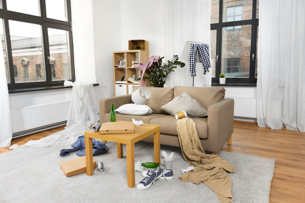 interior of messy home room with scattered stuff
